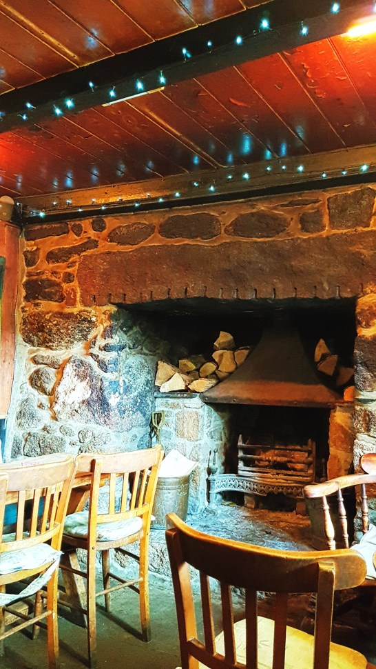 Log fire in the Tinner's Arms